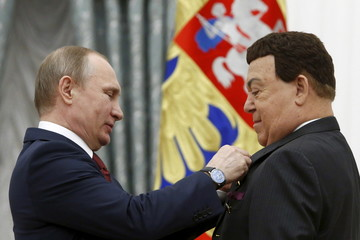 Putin presents Kobzon with the Hero of Labor medal during a ceremony at the Kremlin in Moscow