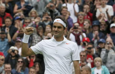 Roger Federer of Switzerland celebrates after defeating Victor Hanescu of Romania in their men's singles tennis match at the Wimbledon Tennis Championships, in London
