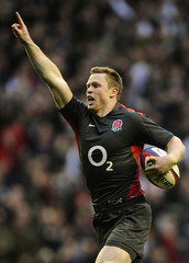 England's Ashton scores a try against Australia during their international friendly rugby match in London