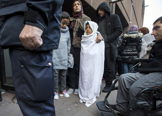 Asylum seekers wait outside the foreign office in Brussels