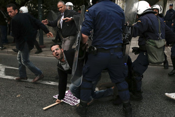 Police try to disperse protesters outside Egyptian embassy in Athens