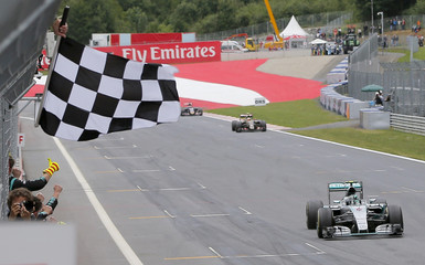 Mercedes driver Nico Rosberg takes the chequered flag to win the Austrian F1 Grand Prix in Spielberg