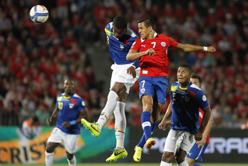 Chile's Sanchez heads the ball to score against Ecuador's Erazo during their 2014 World Cup qualifying soccer match in Santiago