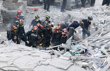 Firefighters and rescue workers search for survivors after a building collapsed in Los Cristianos, in the Canary Island of Tenerife