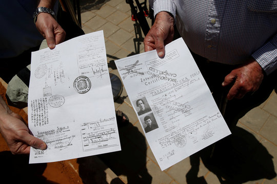 Travel documents issued by Chiune Sugihara which helped save lives of Lithuanian Jews in World War 2 are shown during a street-naming ceremony in honour of Sugihara in Netanya