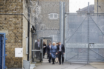 Britain's Camilla, The Duchess of Cornwall, is shown round Brixton Prison by Governor Giles Mason, in south London