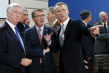 Britain's Defence Secretary Fallon, U.S. Defense Secretary Carter and NATO Secretary-General Stoltenberg attend a NATO defence ministers meeting in Brussels
