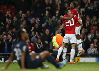 Manchester United's Valencia and Robin van Persie celebrate a second goal against Olympiakos during their Champions League soccer match in Manchester