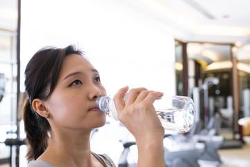Asian woman drinking water