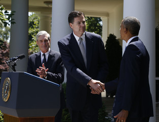 U.S. President Obama shake hands with Comey, his choice to replace Mueller as the next FBI director, in the Rose Garden of the White House in Washington