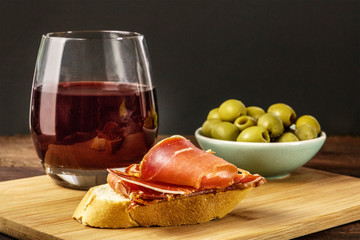 Jamon tapa, cured ham on bread with wine