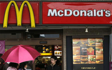 Passersby walk past a McDonald's store in Tokyo