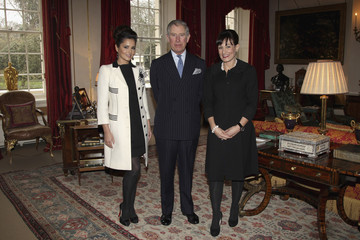 Pop singer Cheryl Cole poses with Britain's Prince Charles as she launched a charity at Clarence House in London