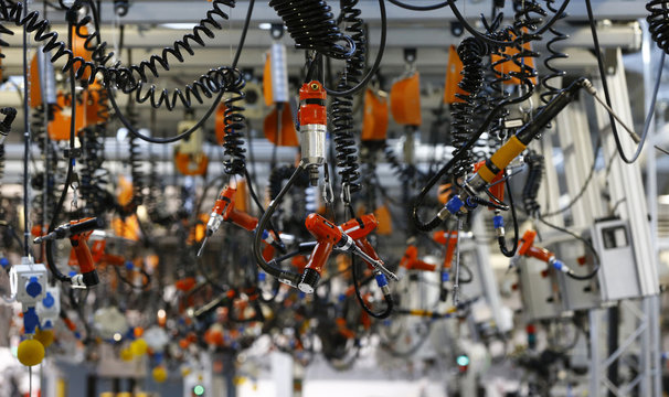 Various tools are seen hanging from the ceiling at the engine manufacturing unit for the new Mercedes AMG GT super sports cars at the Mercedes AMG headquarters in Affalterbach