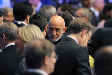 Afghanistan's President Hamid Karzai arrives at a working session on the second day of the 2012 NATO Summit in Chicago