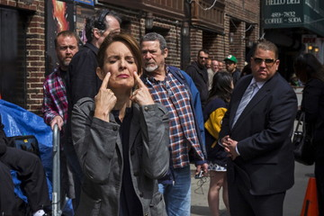 """Comedian Tina Fey pretends to cry as she arrives at Ed Sullivan Theater in Manhattan as David Letterman prepares for the taping of tonight's final edition of """"The Late Show"""" in New York"""