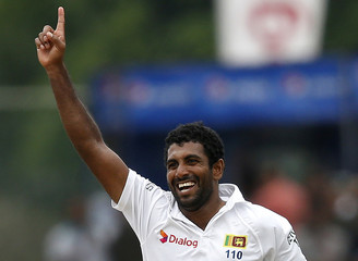 Sri Lanka's Prasad celebrates after taking the wicket of Pakistan's Manzoor during the fourth day of their second and final test cricket match  in Colombo
