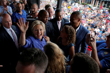 U.S. Democratic presidential nominee Hillary Clinton greets supporters after speaking to the overflow crowd outside a campaign rally at the Manor Complex in Wilton Manors