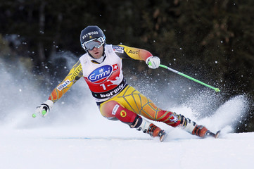 Dixon takes a curve during the second training session of the men's downhill Alpine Skiing World Cup in Bormio