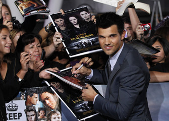 "Cast member Lautner signs autographs at the premiere of ""The Twilight Saga: Breaking Dawn - Part 2"" in Los Angeles"