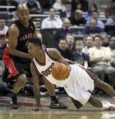 Milwaukee Bucks guard Brandon Jennings passes as he slip against the Toronto Raptors in Milwaukee