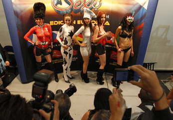"""Dancers in body paint pose for pictures during a news conference to promote the """"Expo Sex and Entertainment"""" adult exhibition in Mexico City"""