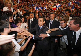 Supporters shake hands with France's President and UMP party candidate for the 2012 French presidential elections, Nicolas Sarkozy, in Toulon