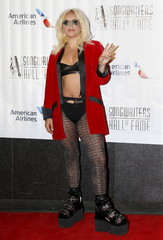 Lady Gaga poses on the red carpet before the Songwriters Hall of Fame ceremony in New York