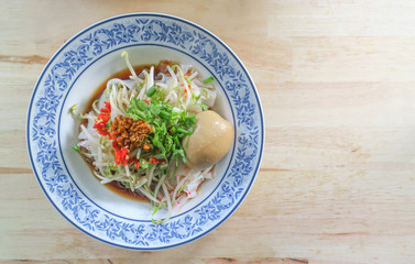 Wide rice noodles and sauce with vegetables and egg, Thai style