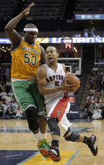Toronto Raptors guard Bayless drives to basket against Memphis Grizzlies forward Randolph during second half of NBA basketball action in Memphis