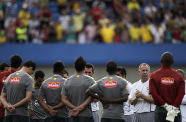Brazil's head coach Mano Menezes talks with his players during a training session in Goiania