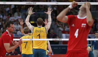 Australia's Peacock and Zingel celebrate a point against Poland during their men's Group A volleyball match at Earls Court during the London 2012 Olympic Games