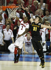 Louisville Smith scores on Wichita State Baker in the second half of their NCAA men's Final Four basketball game in Atlanta