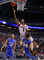 Louisville guard Ware goes to the basket over Duke forward Kelly during their Midwest Regional NCAA men's basketball game in Indianapolis