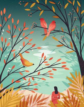 Woman beneath trees with birds