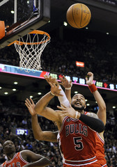 Bulls Boozer goes for a rebound against the Raptors during their NBA basketball game in Toronto