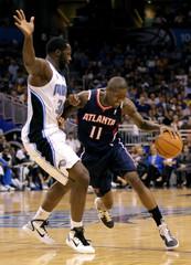 Atlanta Hawks' Crawford drives against Orlando Magic's Bass during their NBA basket ball game in Orlando