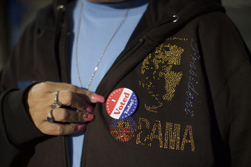 Tina Spann, 49, displays a 'I Voted Today' sticker on her sweatshirt with a President Barack Obama logo, after she greeted Democrat challenger for Pennsylvania Governor Wolf, on election day morning in Philadelphia