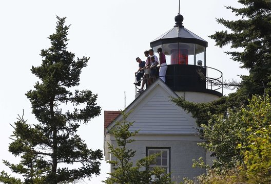 U.S. President Barack Obama and his wife Michelle tour Bass Harbour Head Lighthouse with their children Sasha and Malia in Maine
