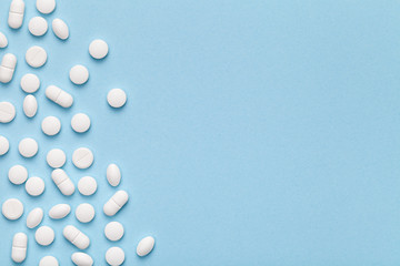 Medical Pills on Blue Background