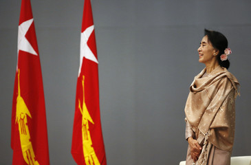 Myanmar's pro-democracy leader Aung San Suu Kyi smiles during a meeting with a group Myanmar citizens residing in Japan, in Tokyo