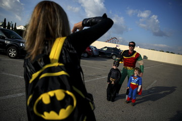 Participants wearing superhero costumes have their picture taken before the World DC Comics Super Heroes event in San Martin de Valdeiglesias, near Madrid