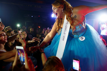 "Contestant Duru Colgulu celebrates after awarded with a ""Sympathy prize"" during the Angel of Turkey transgender/transsexual beauty pageant in Istanbul"