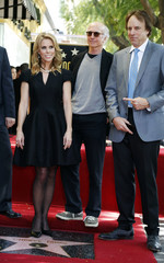 Actress Cheryl Hines poses with guests Larry David and actor Kevin Nealon during ceremonies honoring her with a star on the Hollywood Walk of Fame in Hollywood