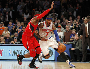 New York Knicks forward Anthony drives to the basket to score the winning points as Atlanta Hawks forward Smith defends in the fourth quarter of their NBA basketball game at Madison Square Garden in New York