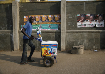 Garuba Musa, an ethnic Hausa Muslim man, pushes an ice-cream cart in Ikeja district in Lagos