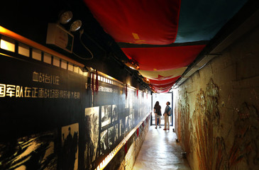 Communist symbols adorn the roof and walls of the entrance to a cave that was once the headquarters of former Chinese Communist military leader Lin Biao, located in mountains on the outskirts of Beijing