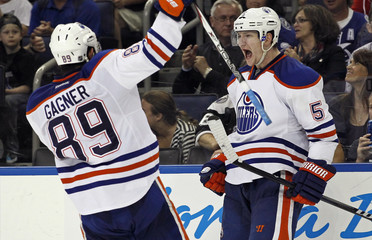 Edmonton Oilers' Smid celebrates his goal with teammate Gagner during the third period of an NHL hockey game against the Tampa Bay Lightning in Tampa