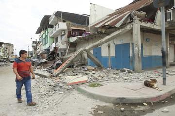 A man walks past debris in Pedernales