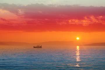 Silhouette of motor boats in the sea In  saturated colors. Seascape. Minimalism